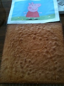 Now comes the fun part! My method is as follows: 1. Draw outline of Peppa on to cake with a small sharp knife