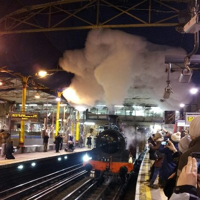The steam train arrives into Moorgate Tube station in a puff of glory