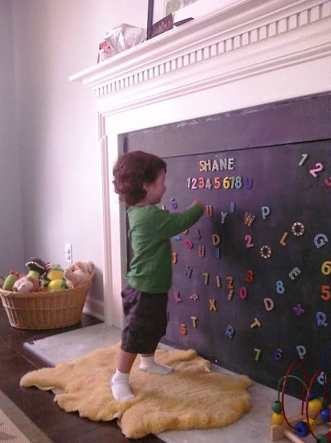What a great idea. Use a magnetic board to cover your fireplace when you have a curious toddler. Nice alternative to the gates they sell.