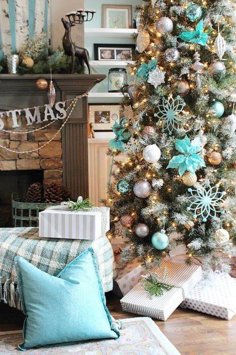 Icy blue Christmas decor with touches of silver, gray, and gold make this Christmas tree a dazzling one.  Get the tutorial at Refresh Restyle.