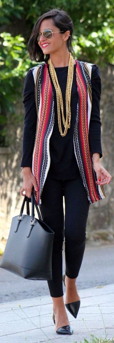 Draw attention while wearing all black by adding a statement necklace