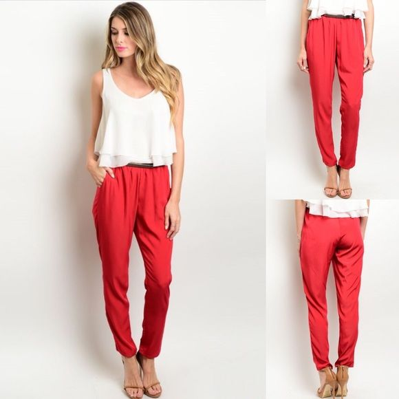 Red Satin Loose, Skinny Pants with Belt New with tags. Red satin feel, loose at the top, skinny pants with belt. Also available in blue, listed separately. Available in S, M, L.                         100% polyester.                                                              Made in USA.                                                                 PRICE IS FIRM UNLESS BUNDLED.                             ❌SORRY, NO TRADES. Boutique Pants Skinny