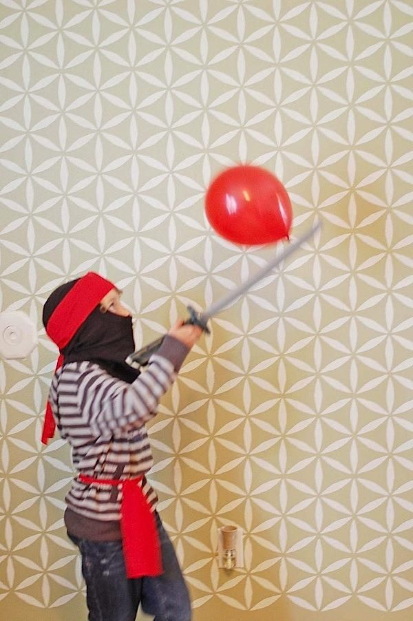 bounce the balloon on the sword game -use pool noodles as swords. Easy ninja party games.