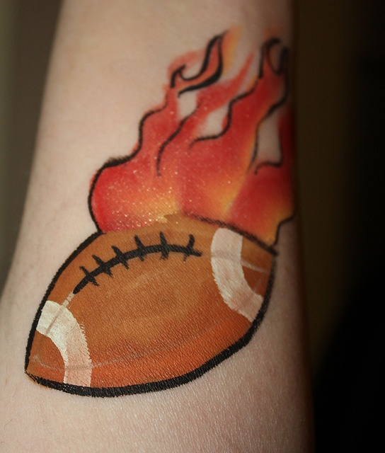 flaming football tattoo by hennajunkie95, via Flickr