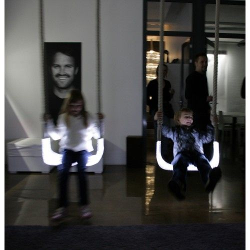 """Sense Light Swing is a light fixture that is also a moving, eye-catching work of art that works well even in large spaces. The shape of the fixture comes from a hanging swing for children; Alexander Lervik´s concept for Sense Light Swing was created, after all, for the 2005 show """"Five Playful Chairs´."""