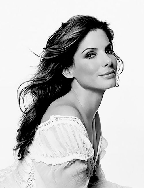Sandra Bullock.  This actually works well for me.  Even the white blouse brings the eye to the center and on Sandra.
