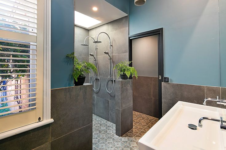 Main limestone bathroom with bath & double shower