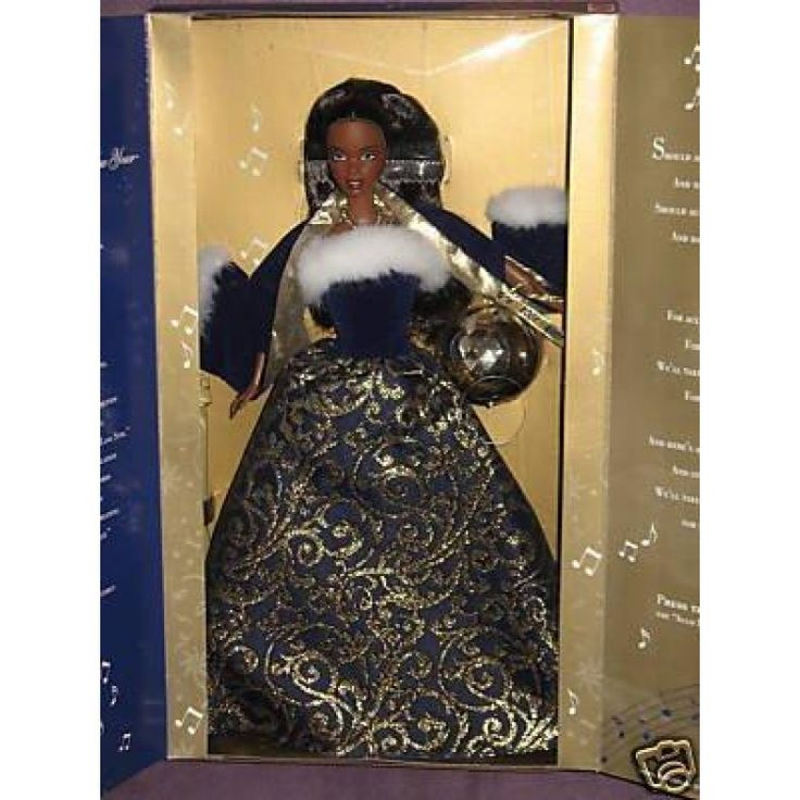 BARBIE - Ring in the New Year - African American  Decorated in full #Holiday #spendor. The golden tapestry inspired print swirls about the dark blue of the full skirt. The softest white faux fur trims her wrap and bodice. A strand of golden beads with a beautiful jewel graces her neck.