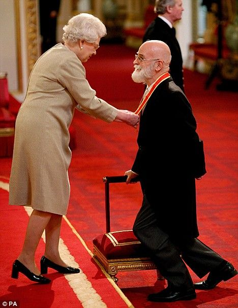 Author Sir Terry Pratchett is knighted by Britain's Queen Elizabeth II at Buckingham Palace