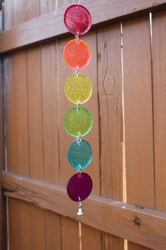 15 long sun catcher made from six 2 solid color plastic circles. Circles are separated by S hooks. This can be used indoors or outdoors.