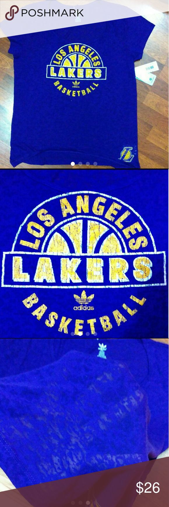 Los Angeles Lakers Tee Brand: Adidas  Size: 2x in women's pretty stretchy material  See through type of shirt (see picture 3)  NWT Bundles are welcome  Ships next day  Los Angeles Lakers  Shirt is a purple NOT A BLUE   Selling on M E R C A R I - SHIPPING IS ON ME Adidas Tops Tees - Short Sleeve