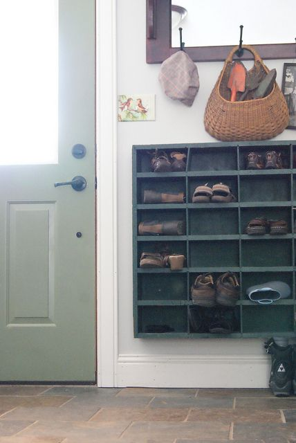 Shoe caddy off the floor in entrance. I like the idea.
