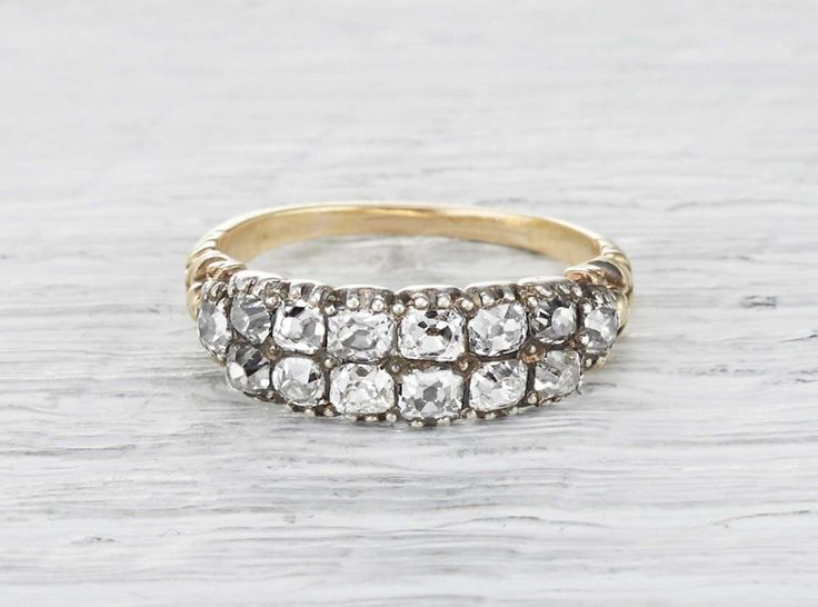Vintage Georgian band made in 15k yellow gold and silver. Set with two rows of six mine cut diamonds. Accented with two additional old mine cut diamonds. Circa 1820.
