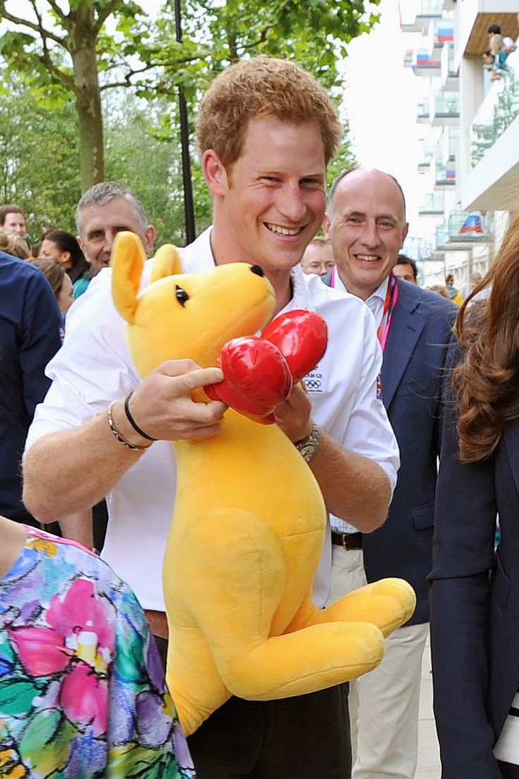 Prince Harry holds a boxing kangaroo, the mascot for Australian Olympic sports, when he visits the Athletes Village in Olympic Park on July 31, 2012, Day 4 of the London Summer Olympics. The royal, an accomplished athlete himself, served as an official ambassador to the Olympic and Paralympic games.