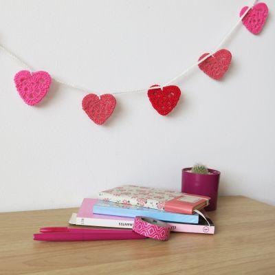 Guirnalda de corazones rosados