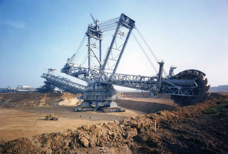 Photograph via mejjad     The $100 million Bagger 288 (Excavator 288), built by the German company Krupp (now ThyssenKrupp) for the energy and mining firm Rheinbraun, is a bucket-wheel excavator or mobile strip mining machine. It only takes 5 people to work this! It takes more than that to get through the drive-thru at Cookout!
