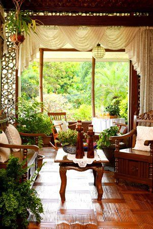 While this living area is found indoors, the space feels like it is connected to nature because of a picture window that provides a great view of the garden. It is furnished with old gallinera chairs made with polished wood that lends warmth to the space. Floors, ceilings and other details are made with kawayan tinik or Bambusa blumeana Schultes, a type of spiny bamboo native to the Philippines.