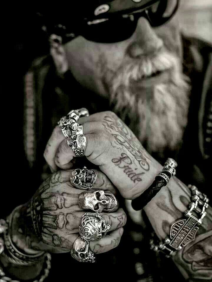 Old school biker wearing biker rings over a unique tattoo on his right hand. #BikerRings LOVE ME SOME OLD SCHOOL~