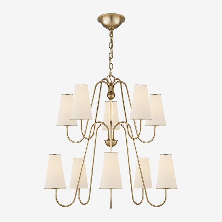 The Montreuil Chandelier in Gild with Linen Shades by AERIN • Inspired by the traditional candelabra, the Montreuil Chandelier with its 10 linen shades and a beautiful curving frame is a sophisticated addition to your home. Shop the Montreuil Collection for matching sconces.
