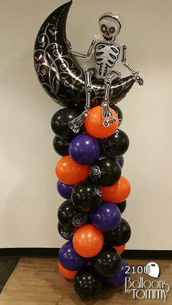 Halloween Balloon Column in black, orange and purple. With a black moon and skeleton mylar balloon on top.