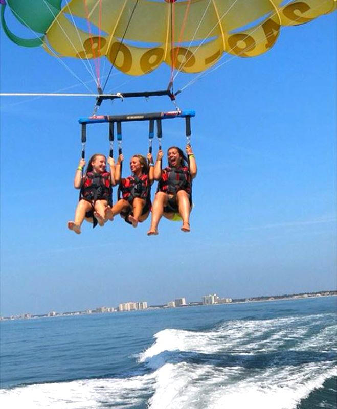 Grab your BFFs and the sky is the limit in Myrtle Beach, South Carolina | Click on the pin for more info on parasailing and more | Photo via Instagram by @shaynabuhagiar