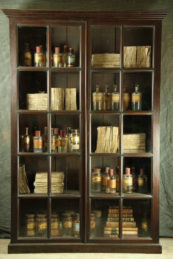 Books and bottles in an English mahogany bookcase