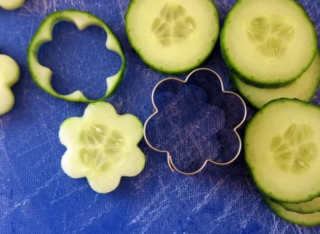 Easy but effective food art! Small cookie cutters for cucumber slices.