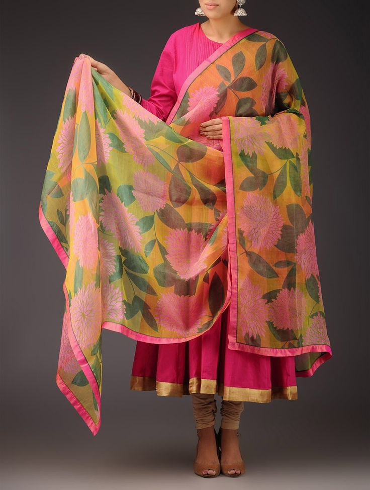 Yellow-Pink-Green Floral Silk Handwoven Printed Dupatta The sheer hand woven silk fabric is seen romancing the chirpiness of colorful floral prints in this beautiful dupatta that is one of its kind. Pair it with a kurti or throw it over like a stole, it will complement both traditional and contemporary wear. For a graceful and ethnic look, pair it with pastel colored anarkalis and churidars.