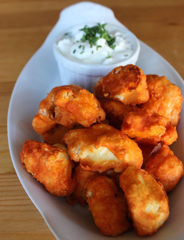 """Prepare to Be Fooled by These Crispy Cauliflower Buffalo """"Wings"""".. I made a similar recipe from Men's Fitness. Regular flour and bread crumbs instead of garbanzo, and no butter at the end, just Frank's wing sauce. YUM!"""