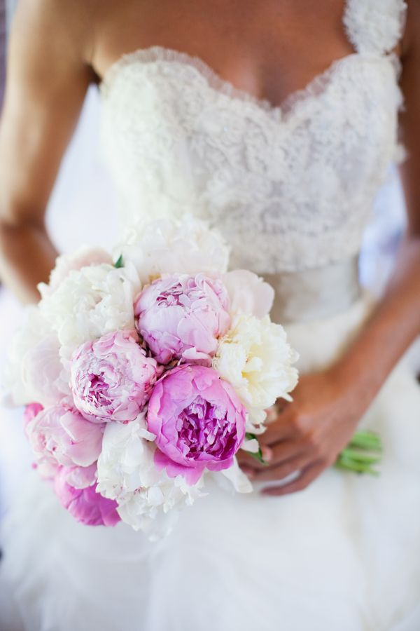 bride with her beautiful pink and white wedding bouquet   photo by Mary Dougherty Photography