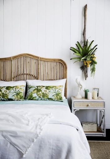 Fresh bedroom with a rattan headboard and tropical throw pillows