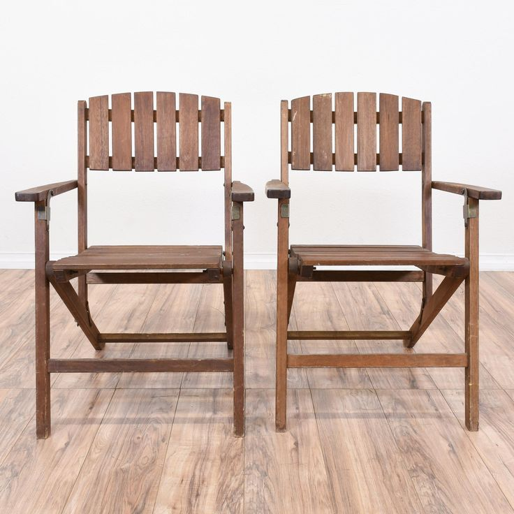 This pair of folding outdoor chairs are featured in a solid wood with a rustic wood finish. These patio chairs are in good condition with folding bases, straight arms and wood slats seats and backs. Great for lounging on a porch or patio! #traditional #chairs #foldingchair #sandiegovintage #vintagefurniture