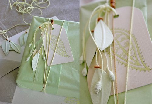 Like the string w/ leaf tag, adornments instead of traditional ribbon.