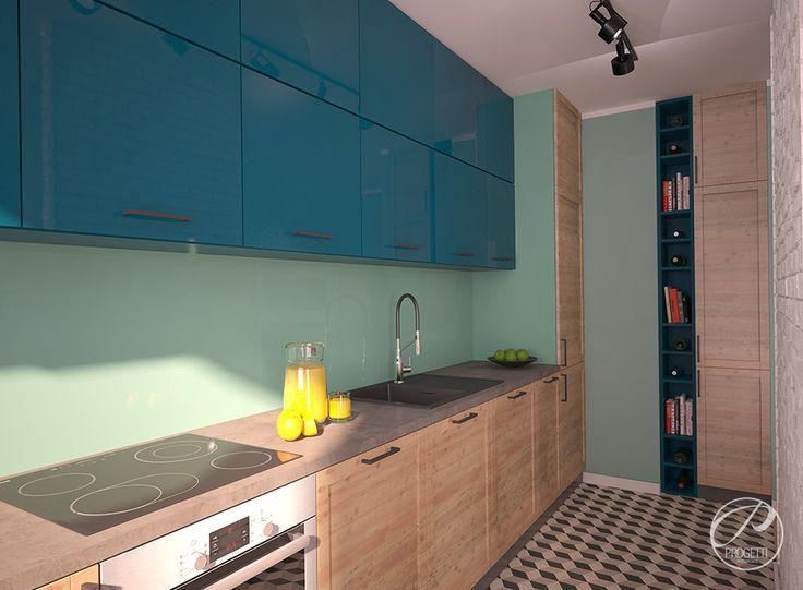 Kolor w mieszkaniu. Projektowanie mieszkań Warszawa.  Kuchnie w nowoczesnym mieszkaniu nie musi być biała. Stylowo urządzone wnętrze można uzyskać wprowadzając kolor. Szafki frontówe kuchennych w kolorze niebieskim oraz okleinie drewnianej. | Progetti Architektura
