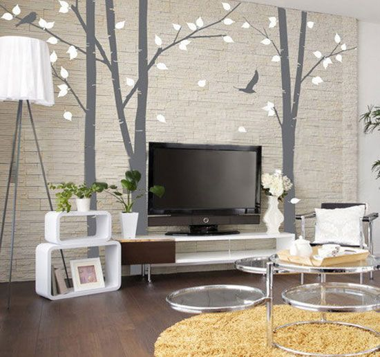 Very  cool way to decorate around your TV using rug/hanging a large textile on the wall