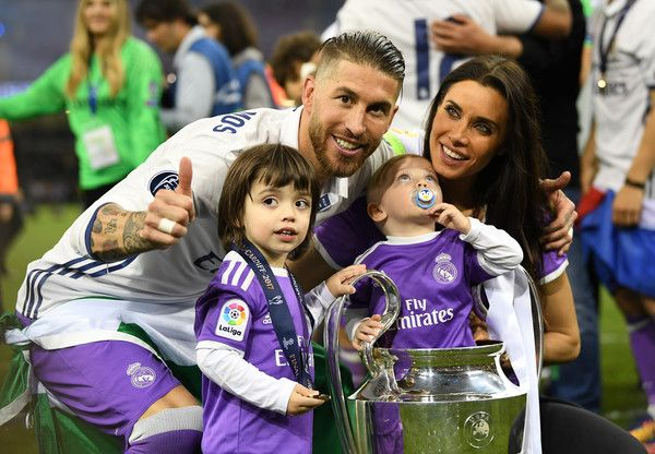 Sergio Ramos of Real Madrid celebrates with The Champions League trophy with his wife and children during the UEFA Champions League Final between Juventus and Real Madrid at National Stadium of Wales on June 3, 2017 in Cardiff, Wales.