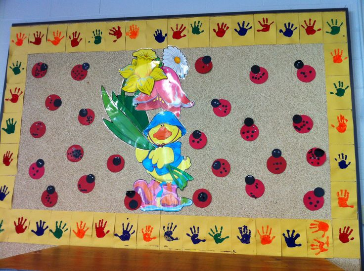 Children's hand prints as the boarder and the ladybugs we made