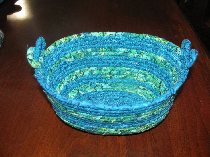 Original Vicki - oval basket from fabric wrapped clothesline - I wrap the fabric around the clothesline using a power drill - these are really fun to make - this one has pretzel shaped handles.