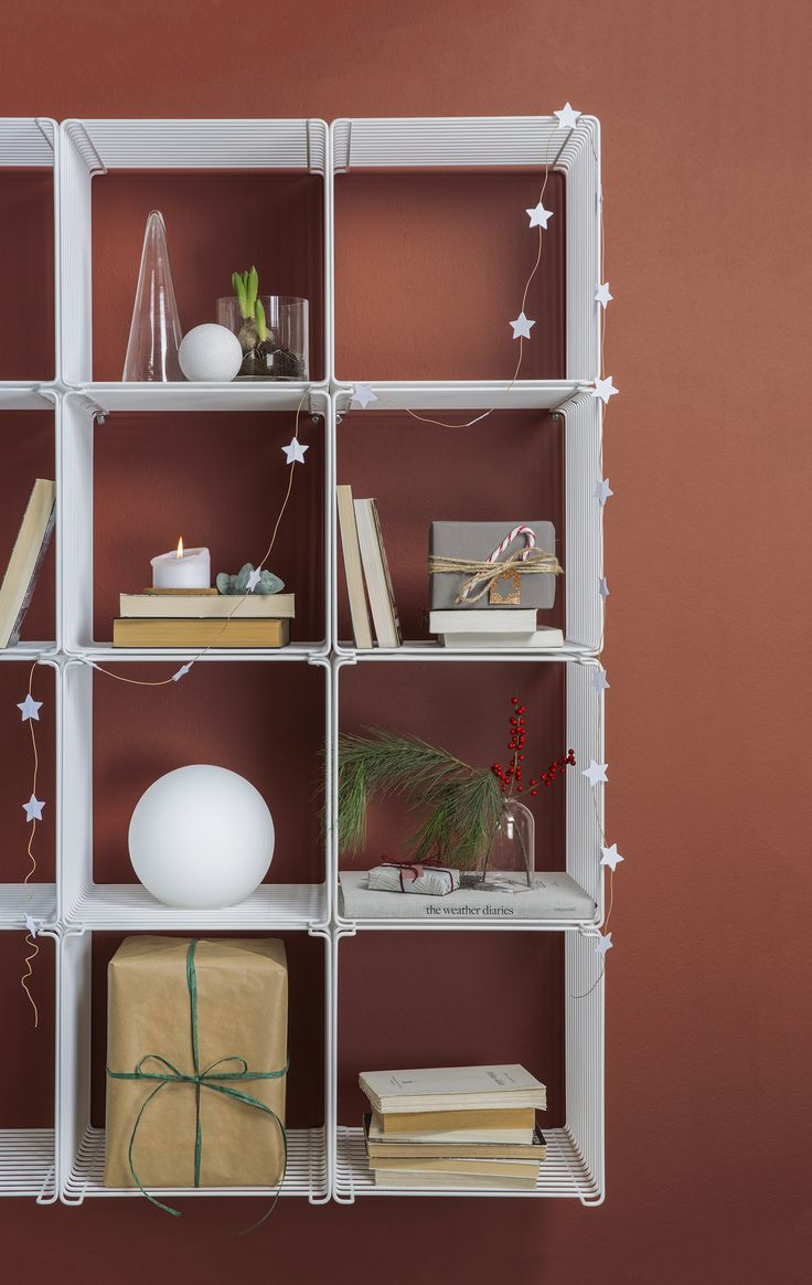 The Panton Wire shelving system is a joy to style for Christmas. #panton #wire #montana #furniture #danish #design