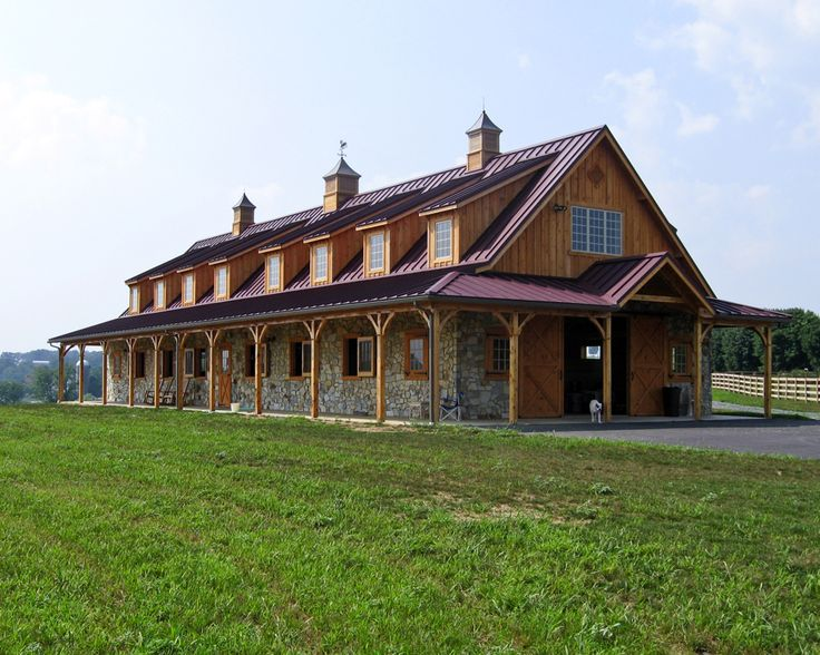 Horse Barn With Red Metal Roof And Stone Wainscotting