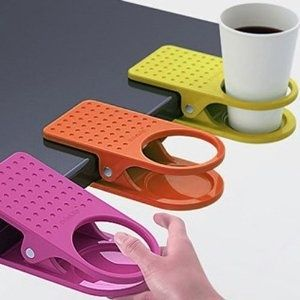 clip-on cup holder for desk or table. out of the way and maybe less likely to spill?