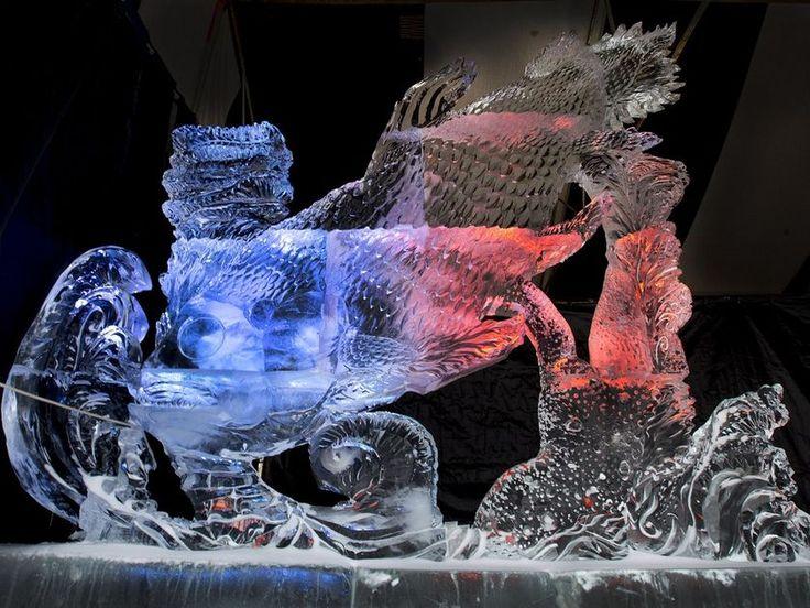 Ice carver unveils massive prehistoric fish sculpture at WinterShines