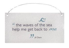 """Quote """"the waves of the sea help me get back to me"""" on a wall plaque"""