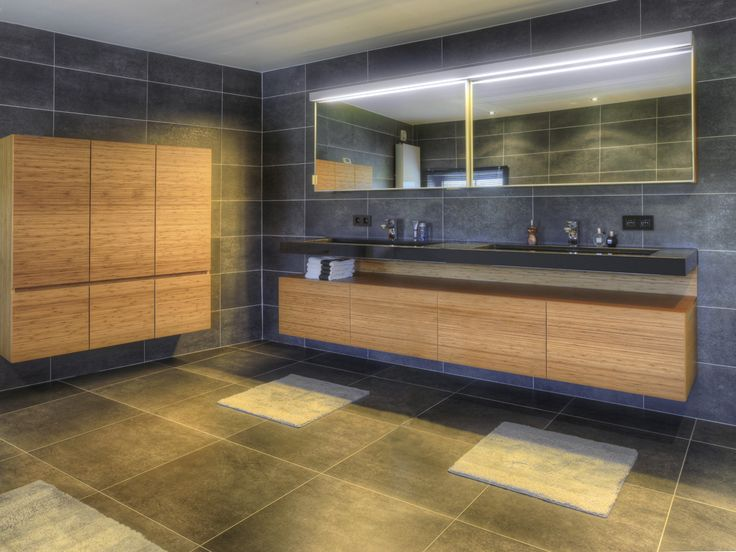 Assenti Pure bathroom furniture tailor made. Designer Lighting and mirror cabinet. Base cabinet in Bamboe Steam.