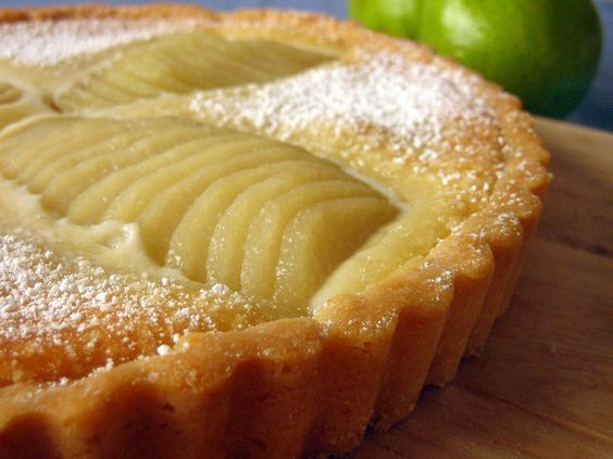 I am going to purchase a tart pan and do this! Pear and Almond Frangipane Tart -This is a classic French tart: marvelously simple to make despite its deceptively complicated appearance, and a perfect showcase of its ingredients: pears, almonds, butter, sugar. The pears are poached in a sugar syrup laced with cinnamon sticks, lemon zest, and vanilla bean