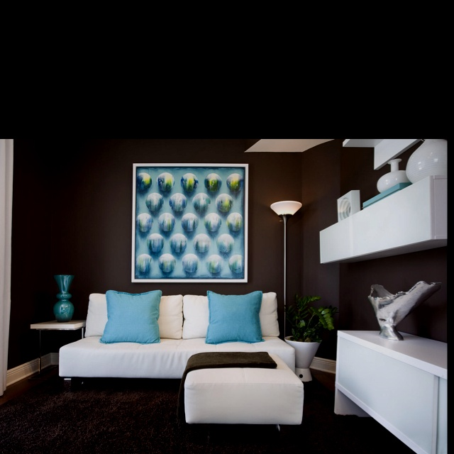 Love the brown wall, white furniture, turquoise/aquamarine accents