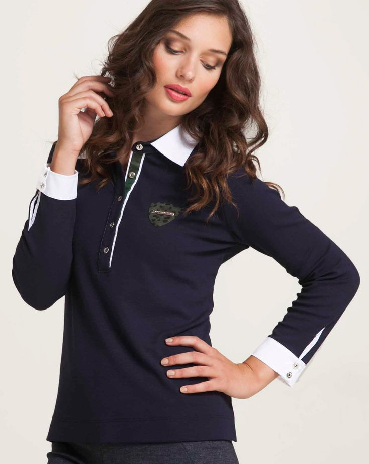 Blouse with white cotton popline polo collar and placket. Contrast trimmings, metal buttons and metal detail logo at chest. Long sleeves with buttoned cuffs. Combine with trousers for sport outfit. http://www.alexanderjacob.com/en/tops-blouses/189-contrast-polo-.html