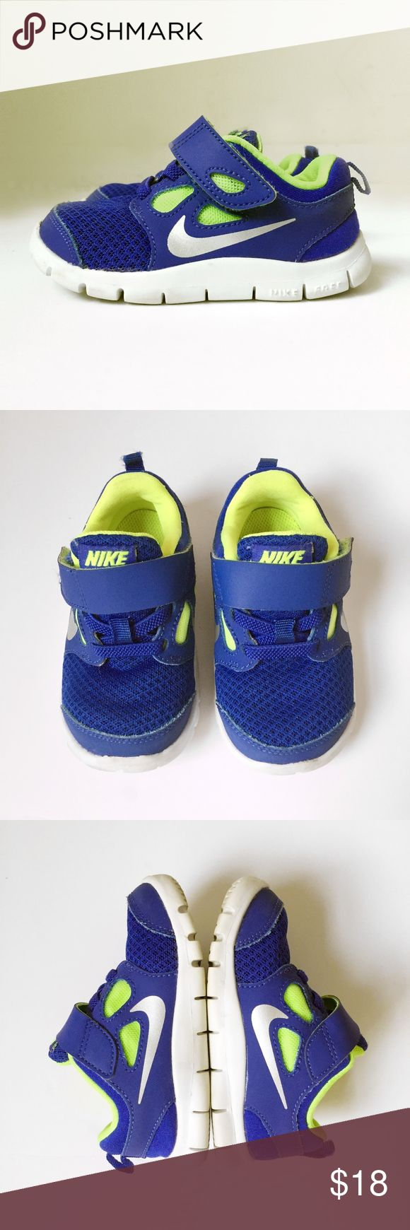 "NIKE FREE 5 blue neon running shoes toddler 6C NIKE FREE 5   easy on/off  velcro closure.  6C toddler  outsole: 6"" x 2.75""  one owner, pet/smoke free.   machine washable, air dry.  running athletic slip ons slip on comfort first lime lemon fluorescent highlighter navy blue sneaker kids boys girls unisex baby preschool grade school lightweight athletic trainers training running sneakers baby infant first walking walker Nike Shoes Sneakers"
