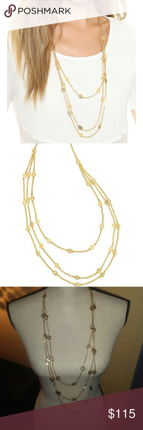 "NWOT Tory Burch Three-Strand Gold Plated Necklace Gorgeous...Perfect...Everything! These are the words that describe this NWOT Authentic Tory Burch Necklace. This necklace is truly stunning in person. Brand New, no tags or dustbag  This is Tory Burch take on the by-the-yard necklace features three draped strands. 16-karat yellow gold plate.  Rolo chains with signature Tory Burch double-T logo stations. Lobster clasp. The three lengths measure: 26"", 32"", and 36"".   Exact same necklace on Saks…"