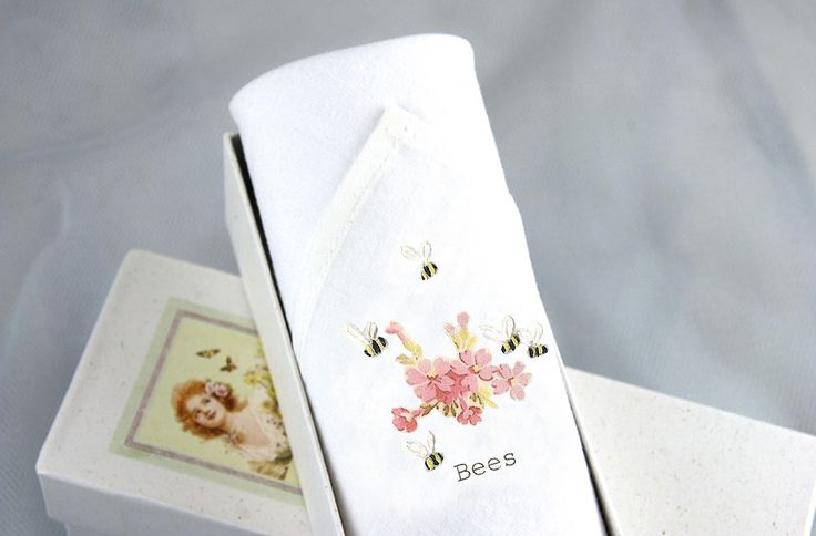 A bouquet of Pink flowers is printed on the softest Cotton with embroidered bees hovering above. An original gift for garden lovers.